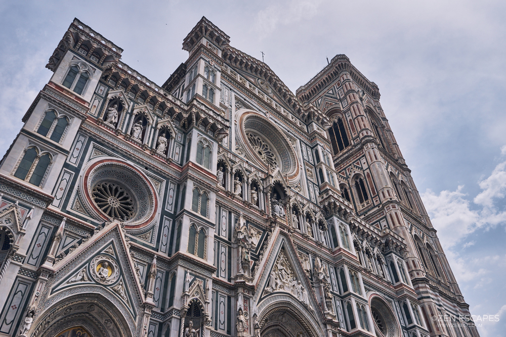 Florence Cathedral, or known as Cattedrale di Santa Maria del Fiore (Cathedral of Saint Mary of the Flower).  This cathedral have a very unique design on its exterior, full with artistic marble panels.