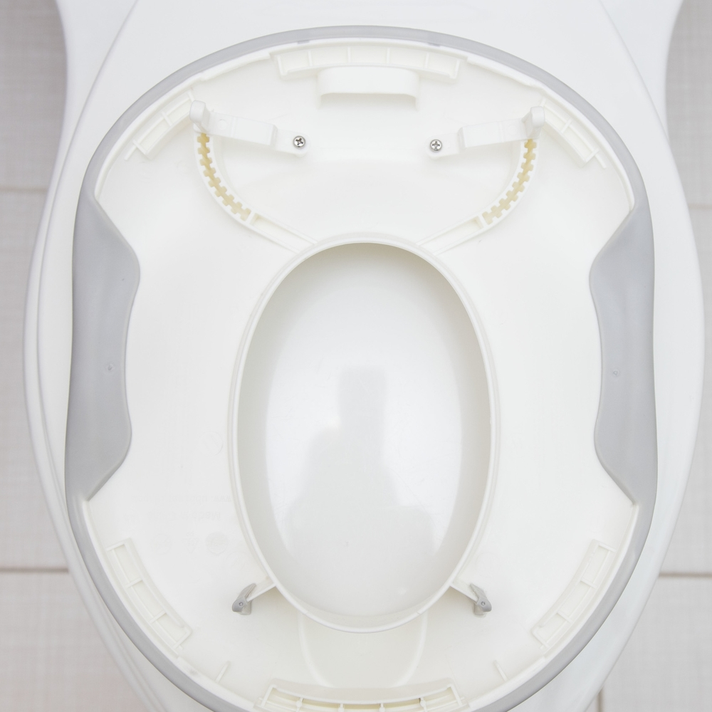 Those notches on the back side allow you to adjust the seat to fit your toilet.