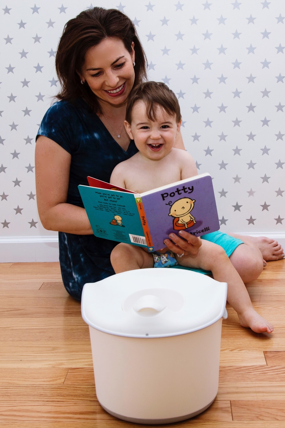 First time seeing the  potty  and reading the  potty book .