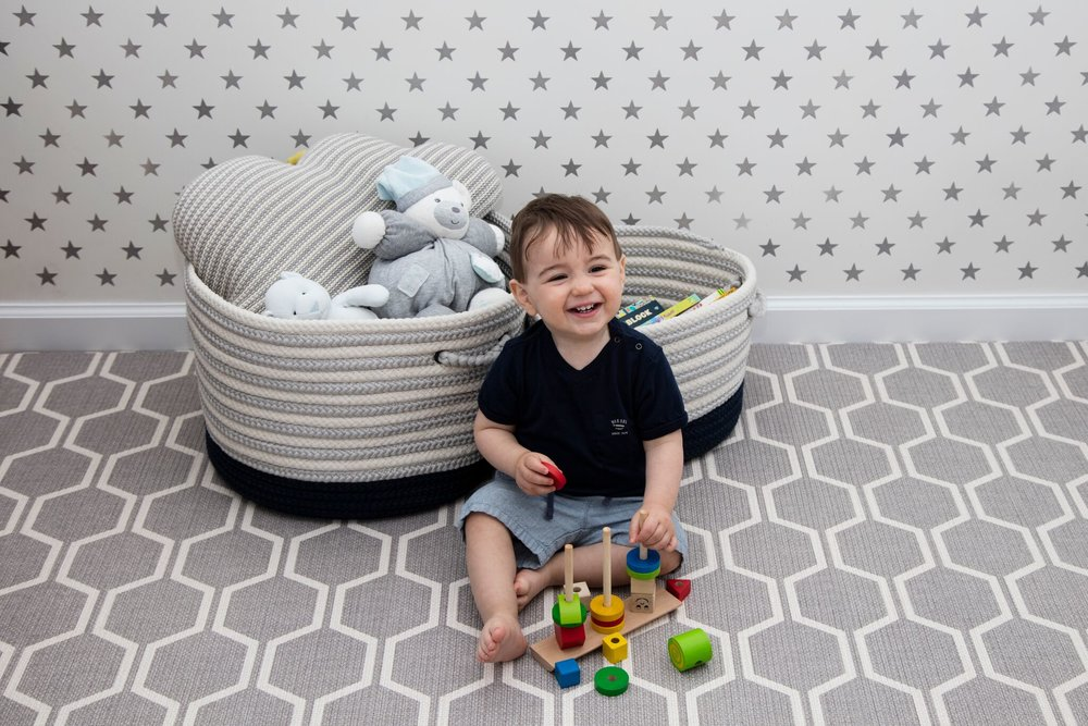 My son happily playing on his  Parklon  mat in his room.  I have since moved the mat to our living room and it blends in there too!  The baskets pictured are available in lots of colors  here  and  here .