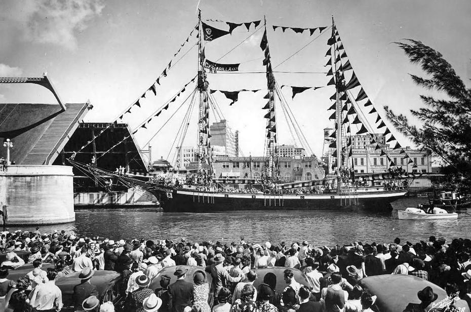 The  William Bisbee,  as the  José Gaspar , sails up the Hillsborough River through the Lafayette St. Bridge, 1938