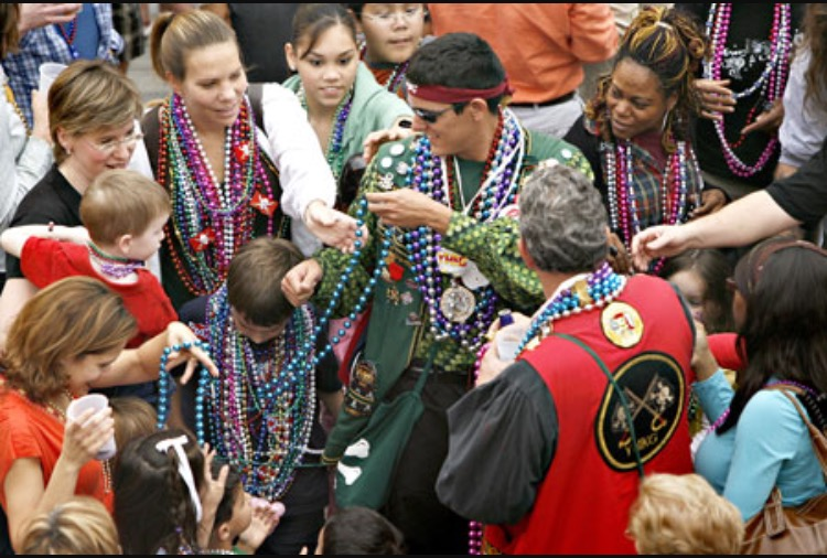 So many hands, trust me, you'll get beads (photo cred @TBO.com)