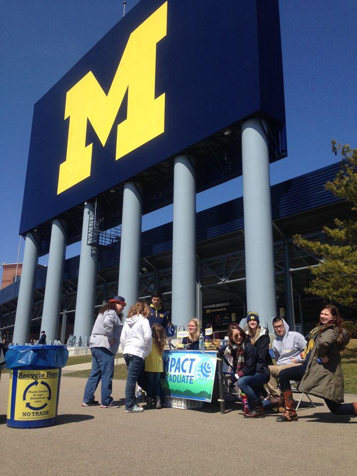 Stadium Recycling Leadership team surveys UM Football fans about the new recycling signage.