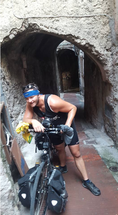 Joey pushing his bike up 10 stories in Italy