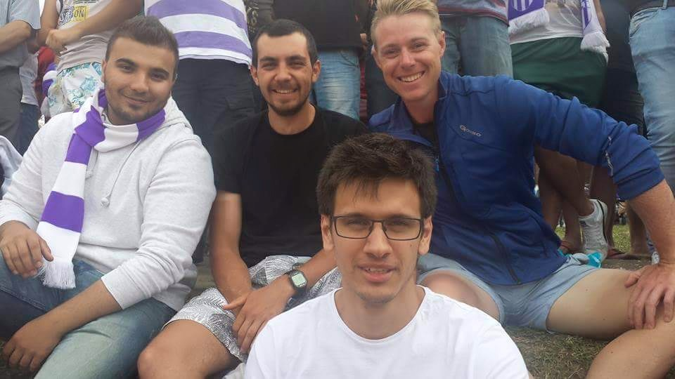 Liam with Adrian (in center) and his friends at a local football game.