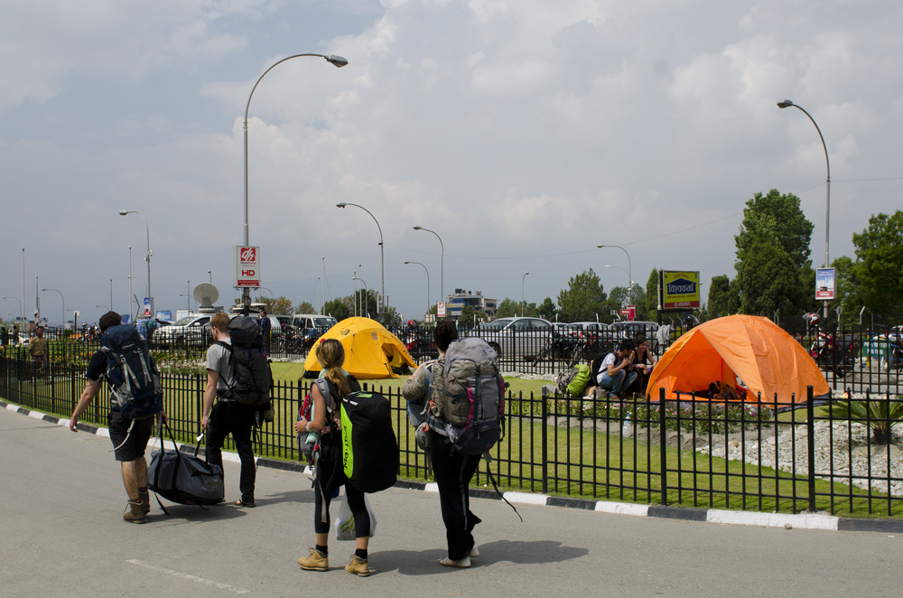 People without tickets literally camping in front of the international terminal in order to check daily for seat availability on any flight heading out of the country