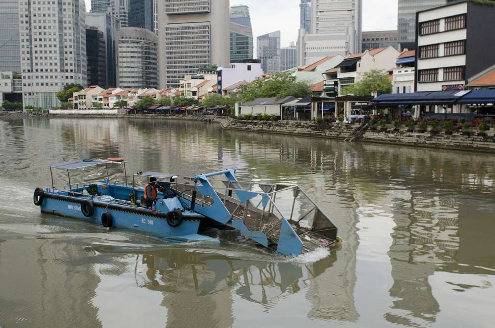 A special boat scooping trash out of the Singapore River