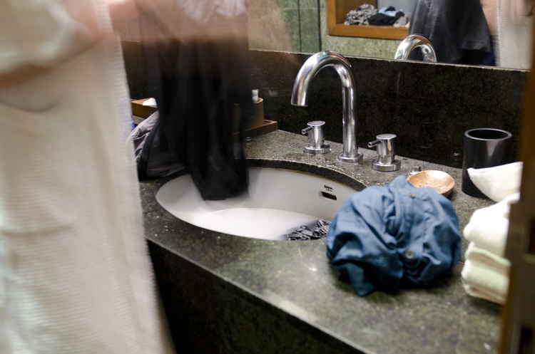 Doing laundry in the bathroom sink in India