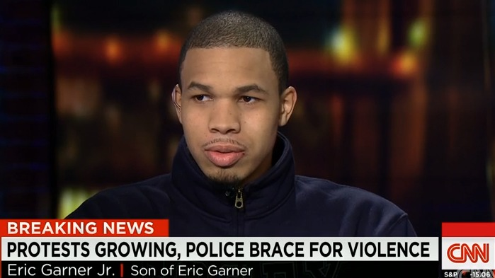"thepoliticalfreakshow: Eric Garner's Son Sits Down For CNN Interview, Opens Up About Father's Controversial Death Eric Garner's 19-year-old son spoke out about his father's untimely death during a rare appearance on CNN last night. Eric Garner Jr. sat down with Erin Burnett Monday night, just days after watching the viral video of his father being choked to death by an NYPD officer. Garner said that he's proud of the peaceful protests happening in New York City and across the country in the wake of his father's death. ""It makes me feel proud because I don't have to share this moment by myself,"" Garner said. ""It's amazing how everybody is doing this for my father. I appreciate it."" Garner also opened up about how he and his friends have been racially profiled throughout the years while living in Staten Island. ""We could just be walking in a group, and cops will stop us because of our color,"" he said. Garner currently plays college basketball and said his father was looking forward to attending his games this season. ""He was a loving, caring father. He always supported his kids. He's been in my life since I was a young kid. He supported my dream, and he was looking forward to watching me play college ball this year."" Source: Chris Witherspoon for The Grio"