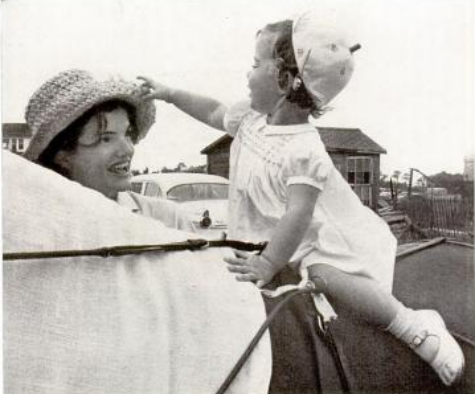 Riding solo atop a pony, Caroline Kennedy has a bit of fun with her mother's straw chapeau.