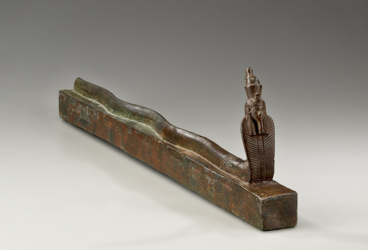 ancientart: An Egyptian snake coffin. Made of bronze, dates to 664-30 B.C.E.. Egyptian religion frequently adopted a mulitplicity of approaches to explain or represent different aspects of a single divine concept. The sun god, for instance, had a morning aspect called Khepri, commonly depicted as a scarab beetle pushing the sun disk across the heavens much as a beetle rolls a ball of dung across the desert floor. The noontime sun was Re or Re-Horakhty, often shown as a falcon or falcon-headed man with a sun disk on his head. Atum, who personified the sun that set over the western horizon to travel through the underworld, could be represented in many guises, including those of a human-headed cobra, a ram-headed man, or a weary old man. Courtesy of the Brooklyn Museum, via their online collections: 36.624.