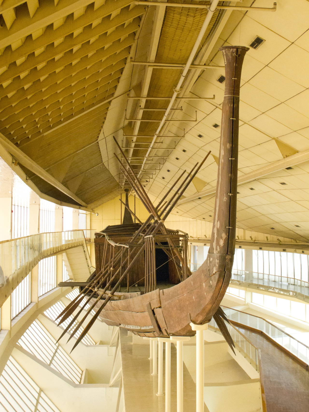 ancientart :     The Khufu ship which was buried  within   Khufu's Pyramid Complex, Giza, Egypt. Dates to about 2650 BC.      The great surviving masterpiece of Old Kingdom shipbuilding is the funerary boat of Khufu, the builder of the Great Pyramid at Giza. […] The Khufu boat was found in a sealed pit next to the Great Pyramid at Giza. Originally there were five boats buried next to the pyramid, of which all but two had been removed in antiquity. The ship is built primarily of cedar, which must have been imported from Syria-Palestine.    […] The function of the vessel is still controversial. Some believe that is was a 'solar' boat, intended to take the dead king on journeys through the heaven with the sun. Others see it simply as the vessel which ferried the king from his residence to the tomb on his funeral day. Others would argue that it was a official vessel that had been used by the Pharaoh on ceremonial occasions. It is impossible to say whether any of the proposed uses would preclude any of the others -in other words, all these theories could be correct. Clearly these fine dimensions would rule out any possibility that it was anything other than a ceremonial vessel of some sort.   -Steve Vinson,  Egyptian Boats and Ships .     Courtesy & currently located at the The Khufu Boat Museum at the Giza pyramid complex. Photo taken by  kairoinfo4u .