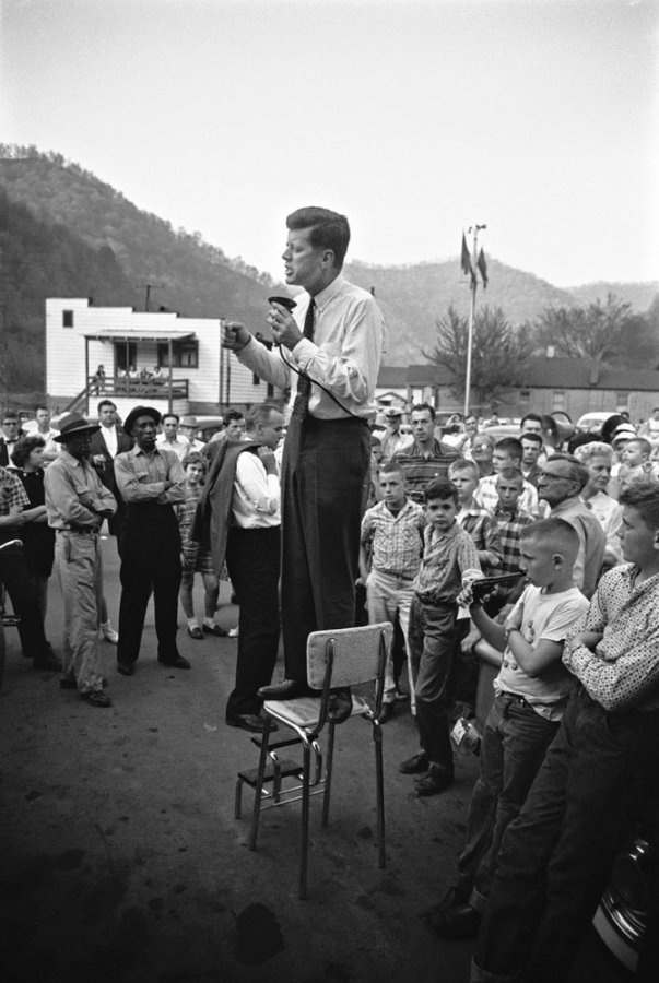 life: As we await another presidential debate this evening, look back at some of our favorite LIFE photos from the campaign trail through the years. Pictured: John F. Kennedy gives a speech while standing on a kitchen chair in Logan County, West Virginia, 1960.