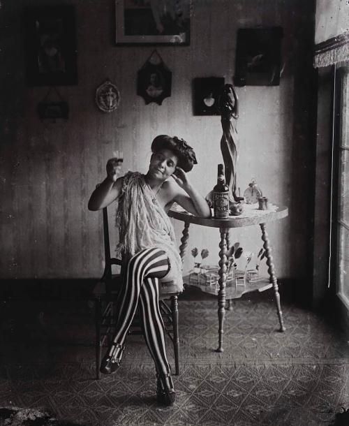silentcuriosity: Storeyville Portraits, prostitute with striped stockings drinking Raleigh rye, E.J Bellocq photographer, New Orleans, 1912. Printed by Lee Friedlander 1967.