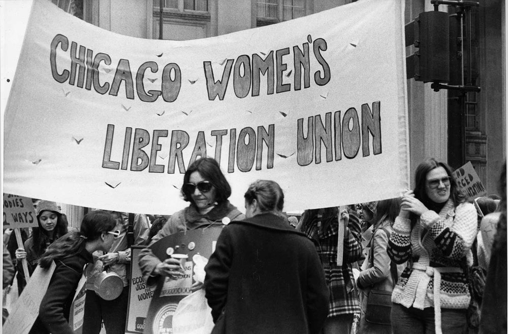 Kim (right) holds CWLU banner