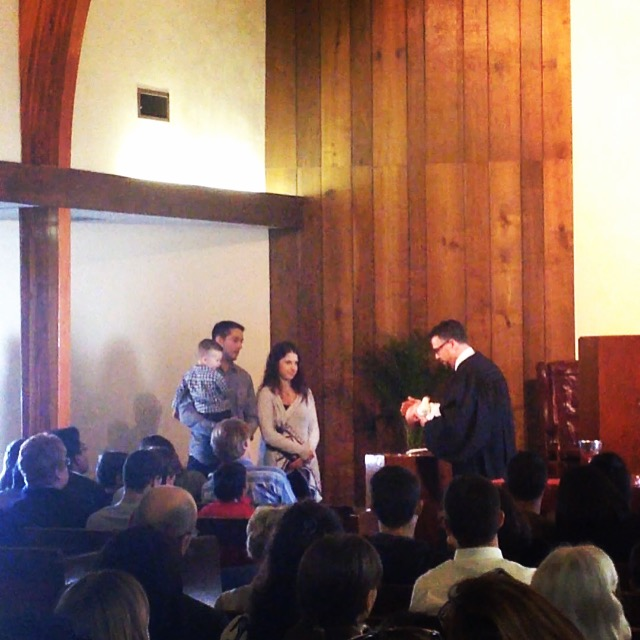 Max receiving the sacrament of Baptism.