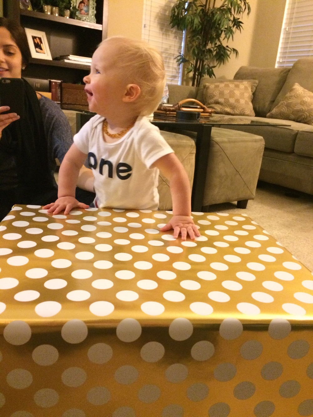 Max opening his present from Nana and Papa.