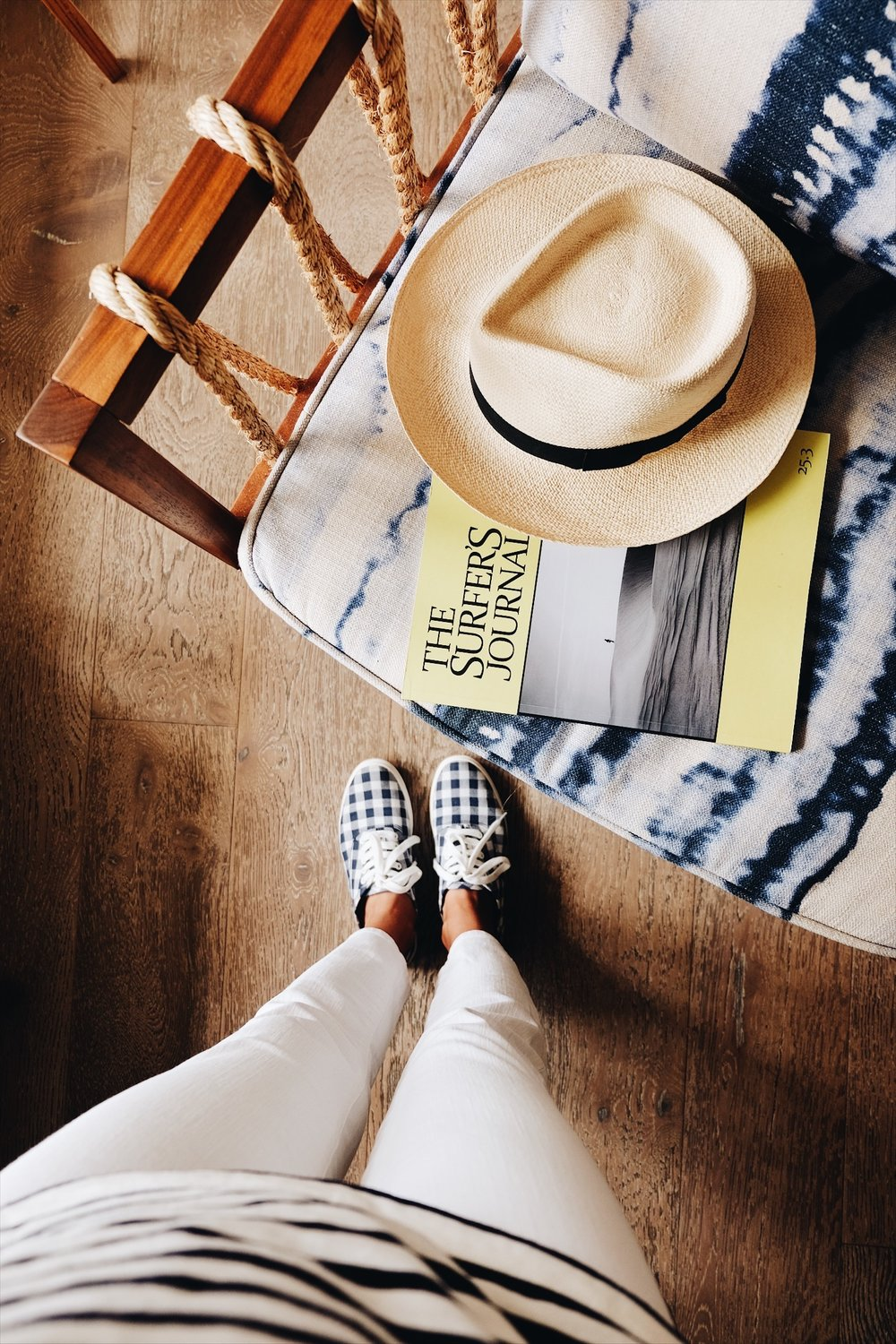 Wearing  these sneakers,   these jeans ,  this top  and  this hat .