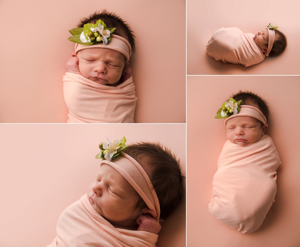 Baby on a pink blanket with an organic tieback headband.