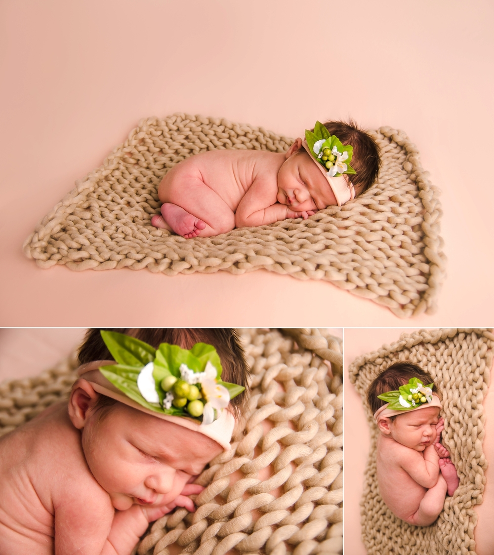 Baby is posed while wearing a headband for newborn pictures.