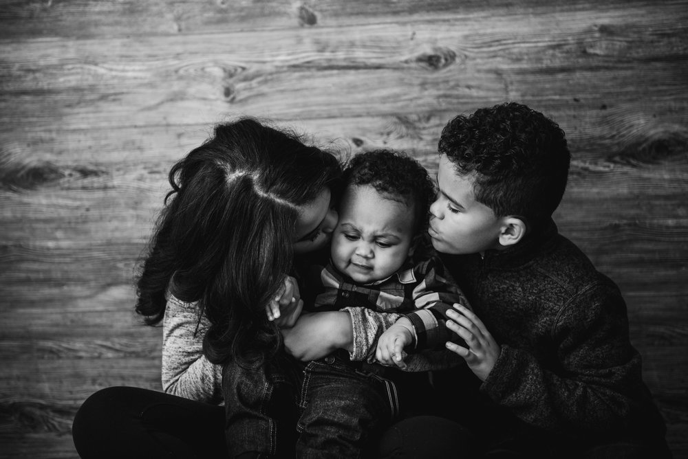 black and white photo of two brothers and a sister