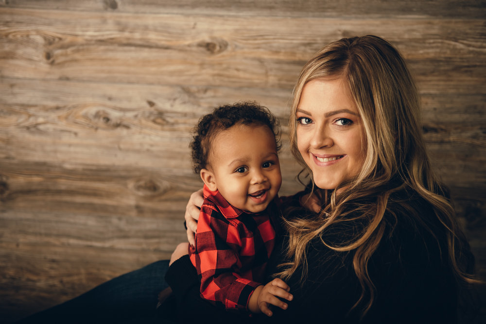 mom and with one year old son at his first birthday photographer session