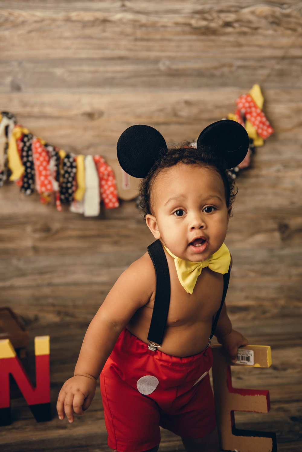 little boy dressed as mickey mouse