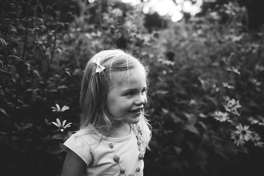 black and white photo of a little girl, taken with a Nikon camera