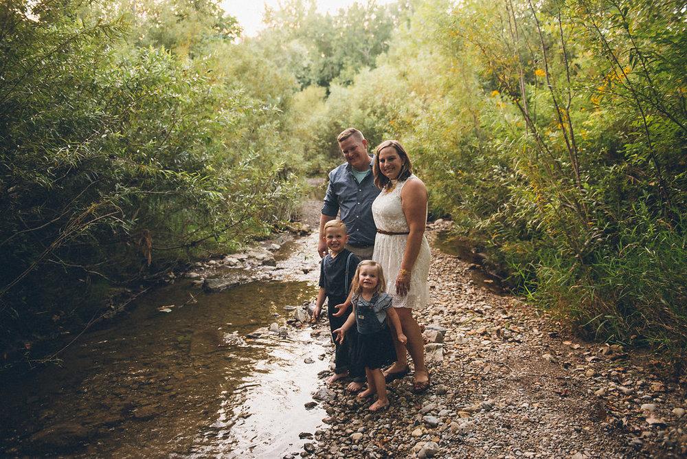 a creek stomp session is a fun idea summer photos