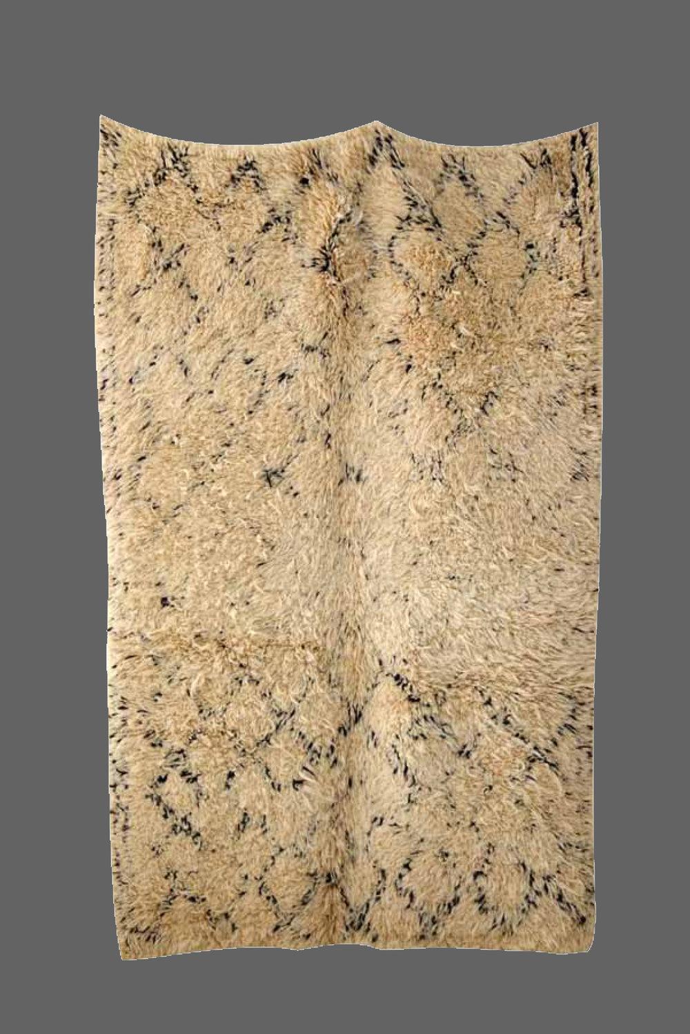 Ethnie : Beni Ouarein    Origine : Maroc    Année : 1990    Dimensions : 2,40 x 1,50    Technique :    Description : Dessin classique, taille rare, laine beige épaisse    Référence : BEN 004    Prix : 1400€