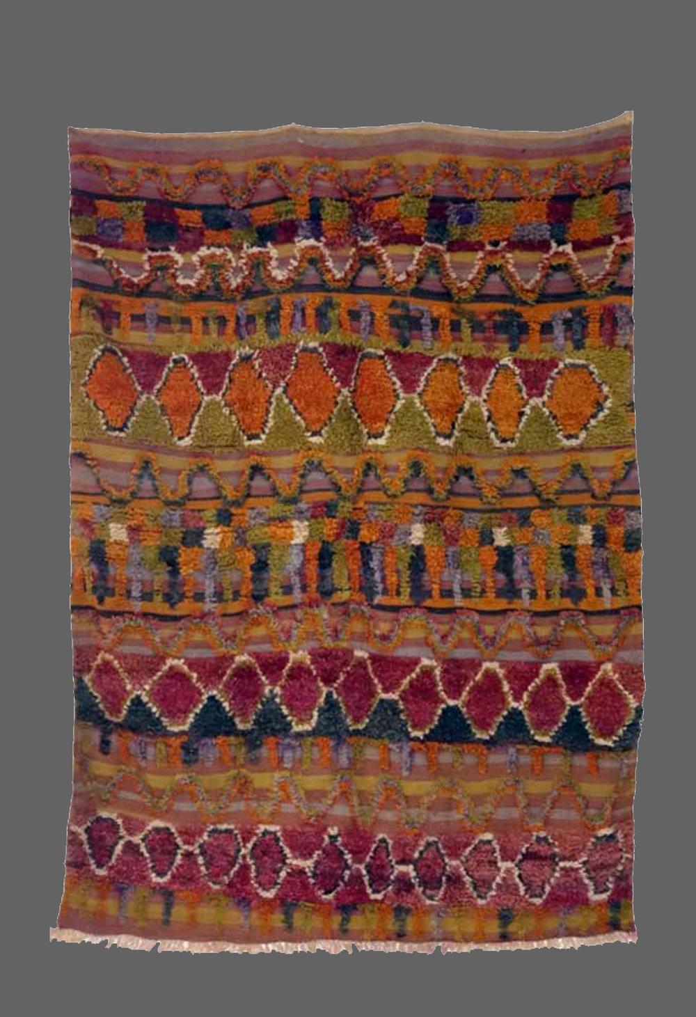 Ethnie : Ait Bou Ichaouen    Origine : Maroc    Année : 1980    Dimensions :    Technique : Noeuds noués    Description : tapis en volume, très beau design, couleurs rares    Référence : AIT 003    Prix : VENDU