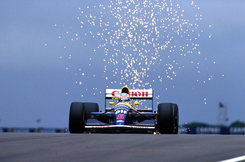 Nigel-Mansell-on-his-way-to-win-the-1991-British-Grand-Prix-Williams-FW14.jpg
