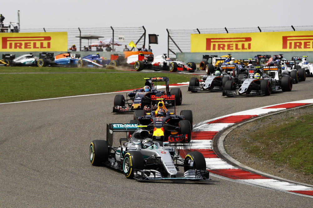 Rosberg races away from pole, Hamilton tries to pass a Manor in the background. (Pic: Mercedes)