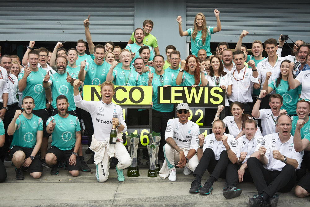 Rosberg wins, although Ham's still smiling. For now. (Pic: Mercedes)