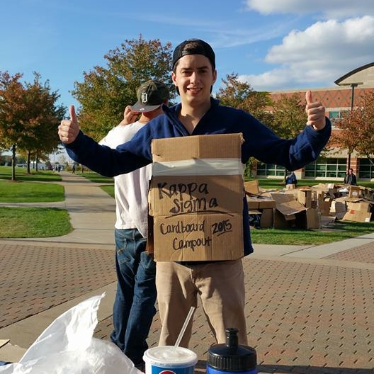 Brother Jason Hoefler promoting the Cardboard Campout on campus!