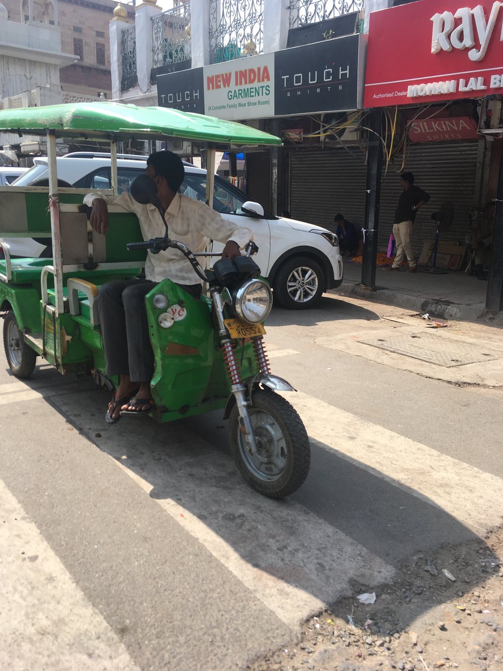 An e-rikshaw. This is a shared rickshaw that usually goes for Rs 10 per seat.