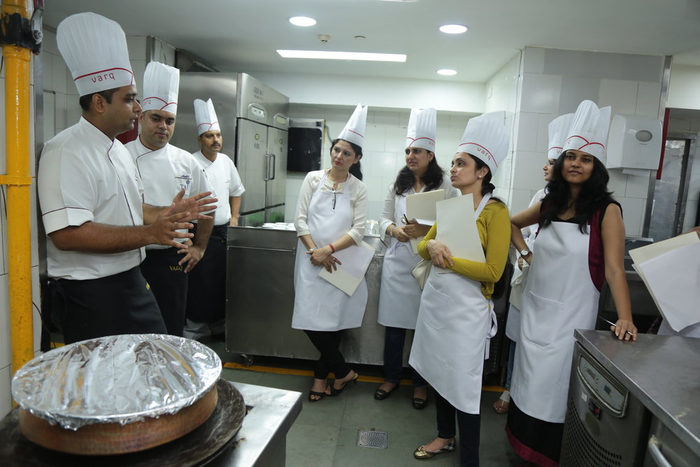 Sous Chef B. Rajesh Kumar Singh (extreme left) demonstrating how to cook biryani on dum