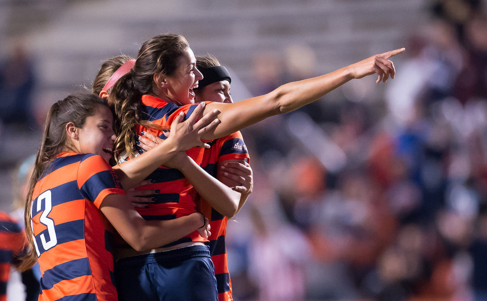 California State Fullerton's Christina Burkenroad celebrates with her teammates after scoring the first goal of their semifinal game held in Fullerton, Calif. on Nov. 5, 2015.