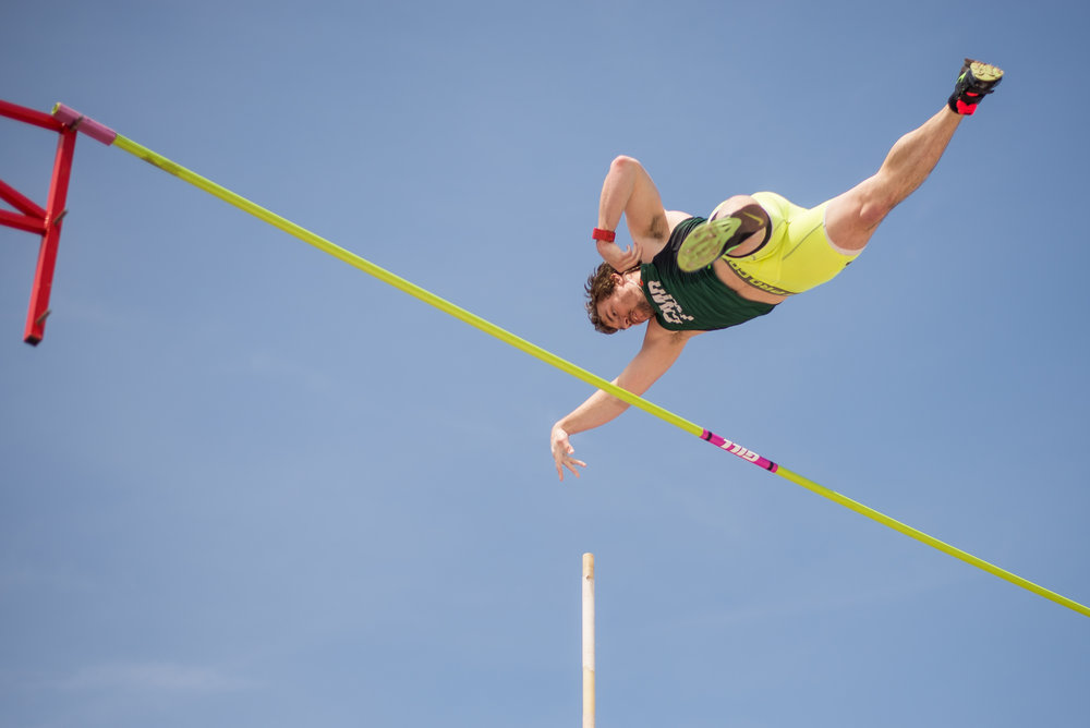 Mike Dempsy makes it over the pole vault bar at the St. John Fisher Cardinal Classic held at St. John Fisher College in Pittsford, N.Y. on April 30, 2016.