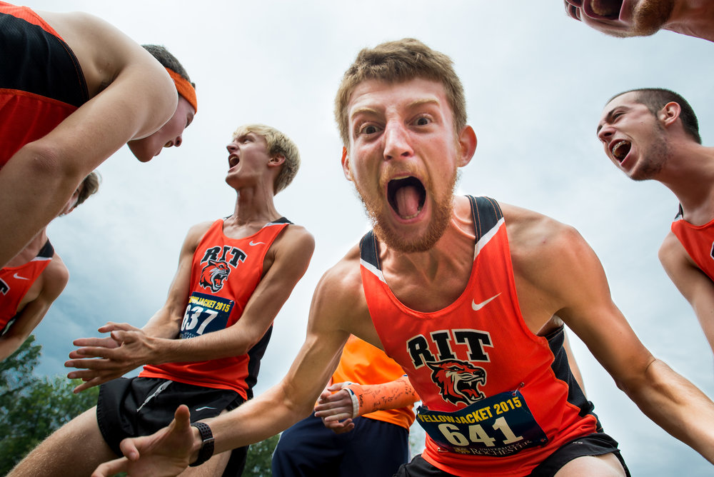 Rochester Institute of Technology's Tim Sunnerberg yells with his cross country teammates in preparation for their race at the University of Rochester Cross Country Invitational, held at Genesee Valley Park in Rochester, N.Y., on Sept. 19, 2015.