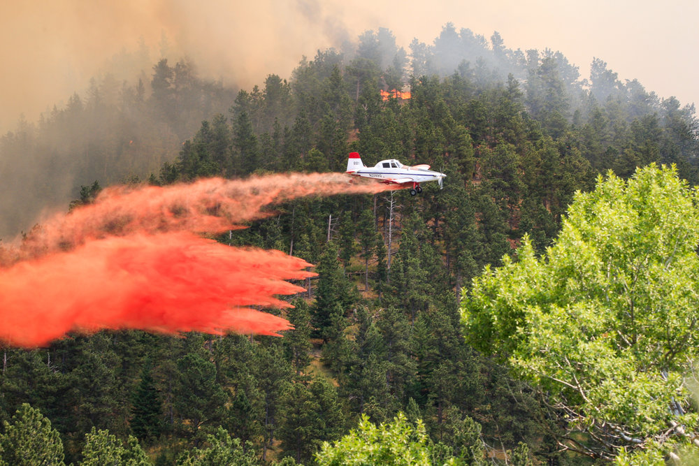 A plane drops retardant on the July Fire.