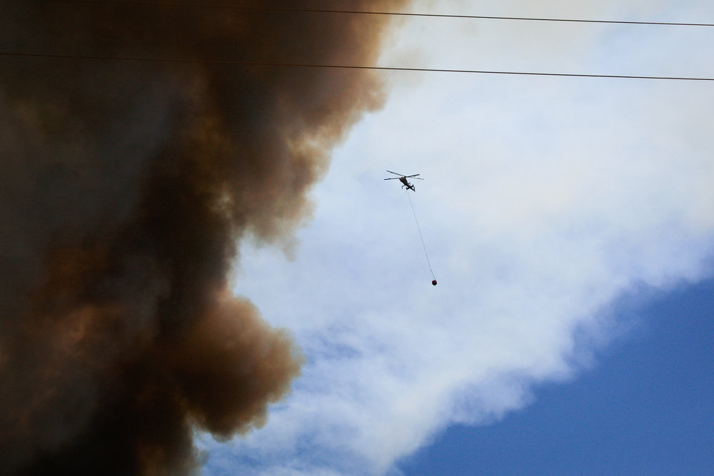 A helicopter flies over the July Fire on July 6, 2017.