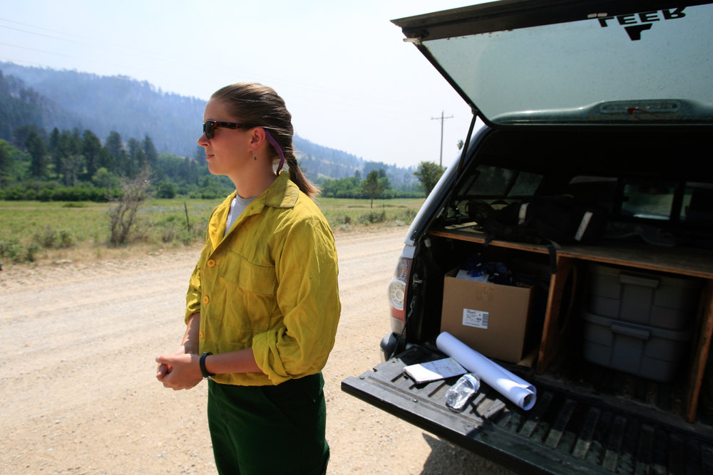 Press Information Officer Hailey Graf stands outside her vehicle after explaining the different logistics of the fire response to media.