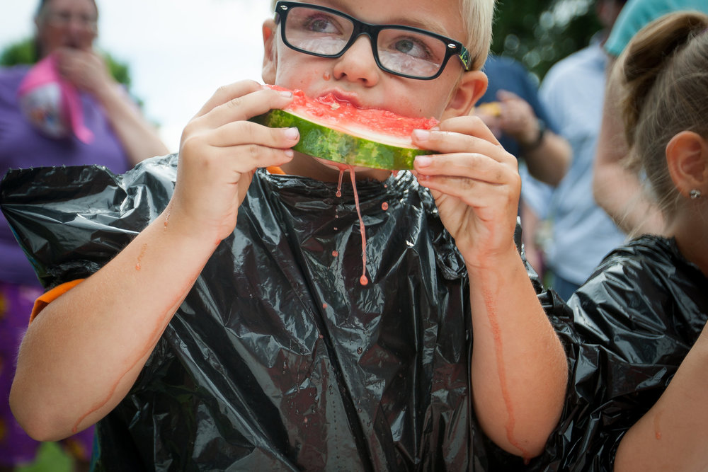 Ed Skarlem devours a watermelon as part of a watermelon eating contest Larimore Days takes place in Larimore, N.D. on July 16, 2016.