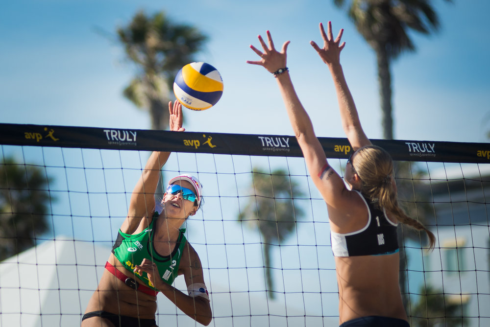 ​Eduarda Santos Lisboa of Brazil spikes against Russia's Nadezda Makroguzova at the FIVB Huntington Beach Open on May 4, 2018 in Huntington Beach, Calif.