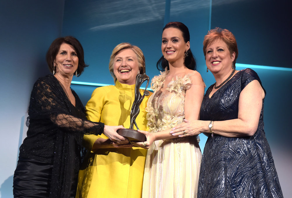 Pamela Fiori, Hillary Clinton, Katy Perry, and Caryl Stern speak on stage during the 12th annual UNICEF Snowflake Ball at Cipriani Wall Street on November 29, 2016 in New York City. (Photo by Jason Kempin/Getty Images for UNICEF)
