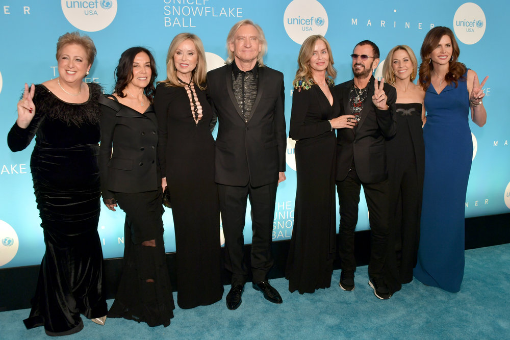 NEW YORK, NY - NOVEMBER 27: (L-R) Caryl M. Stern, Olivia Harrison, Majorie Walsh, Joe Walsh, Barbara Starkey, Sir Ringo Starr, Sheryl Crow, and Desiree Gruber attend the 14th Annual UNICEF Snowflake Ball 2018 on November 27, 2018 in New York City. (Photo by Michael Loccisano/Getty Images for UNICEF)