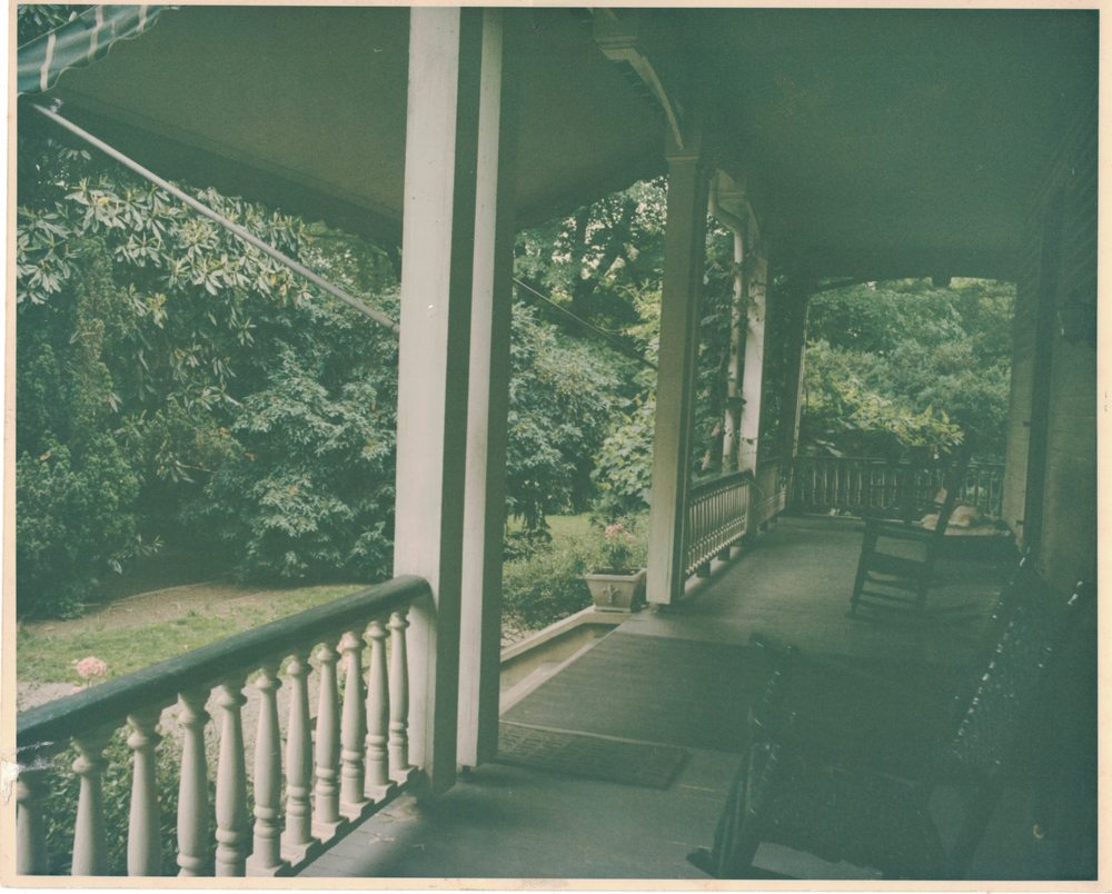 Front porch of Pine Hill Cottage, 1960s. If you look close you can see a dog sleeping in the right-hand corner.