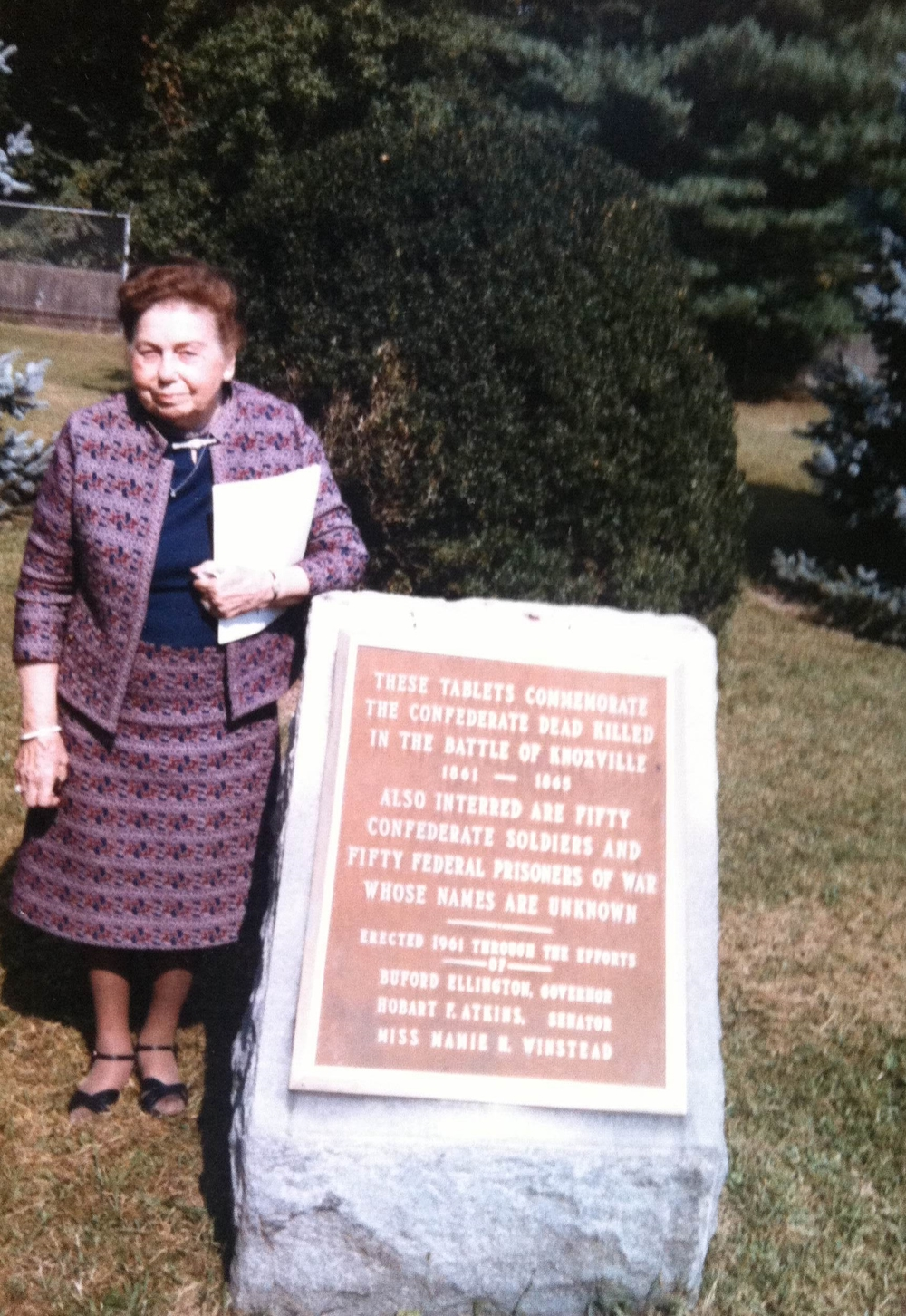 Mamie Winstead stands beside a commemorative plaque at Bethel Cemetery, 1985