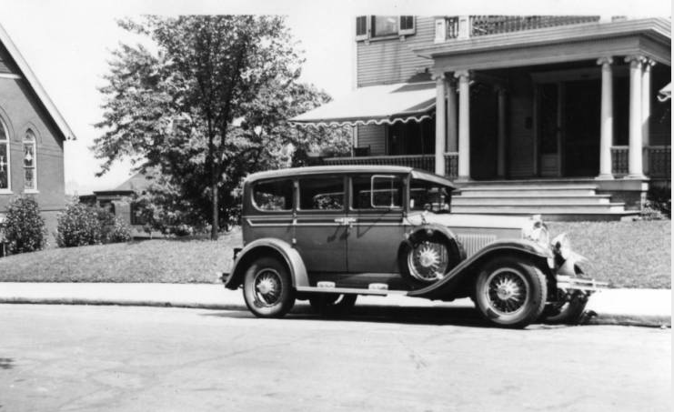 'Flying Cloud' automobile in front of the Frank S. Mead house, 16th Street and Laurel Avenue, Knoxville, TN. Formerly the home of Judge Green. The 'Flying Cloud' is very similar to the 'Auburn' style.  http://cmdc.knoxlib.org/cdm/singleitem/collection/p265301coll005/id/1280/rec/19